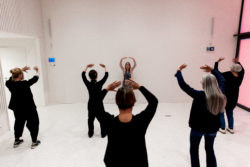 group of 6 persons exercising qigong