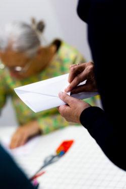 figure folding an envelope
