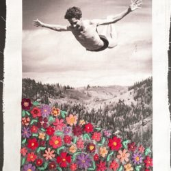 black and white photo on fabric with colourful embroidered flowers