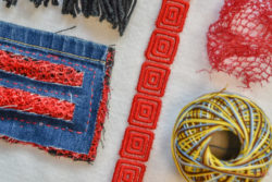 pieces of fabric stitched together, strips of fabric and a ball of sturdy yarn