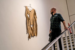 "A visitor looks an artwork in the exhibition ""Soft? Tactile Dialogues""."