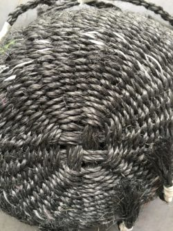 Twined basket of dark grey sisal rope