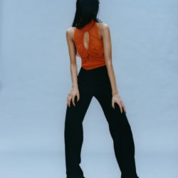 Model in orange top and black trousers, collection Supriya Lele autumn-winter 2021-2022