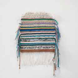 Small woven tapestry with stripes in different colours.