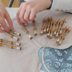 hands making lace