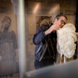 Belgian designer Tim Van Steenbergen handles one of the objects in the exhibition.