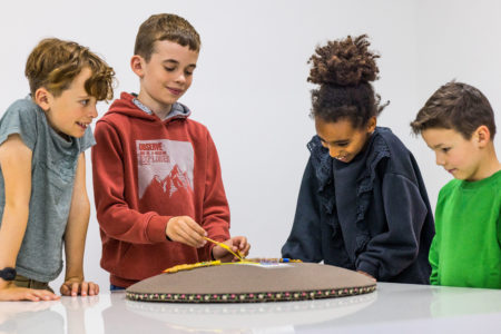 Children learning to make lace