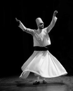Tahsin Surucu of the Haqqani Mevlevi Dervishes dances on stage