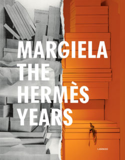 "Book cover of the exhibition ""Margiela, les années Hermès"" at Musée des Arts Décoratifs in Paris. The left side of the image shows white boxes representing Maison Martin Margiela and the right side shows orange boxes representing Hermès."