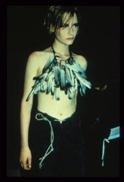 Model on the catwalk with feather top