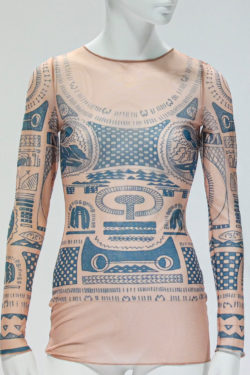 Sheer shirt with patterns printed on it making it look like tattoos on a body when wearing the shirt