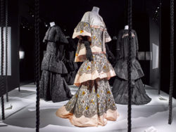 Scenography image of the exhibition: 3 Rochas dresses by Olivier Theyskens