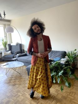 Jaouad Alloul wearing a red blazer at home