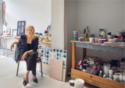 Wide shot of Nel Aerts in her atelier surrounded by her work