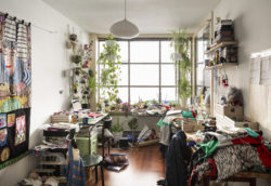 Shot of Klaas' studio with his embroidery work scattered across the room