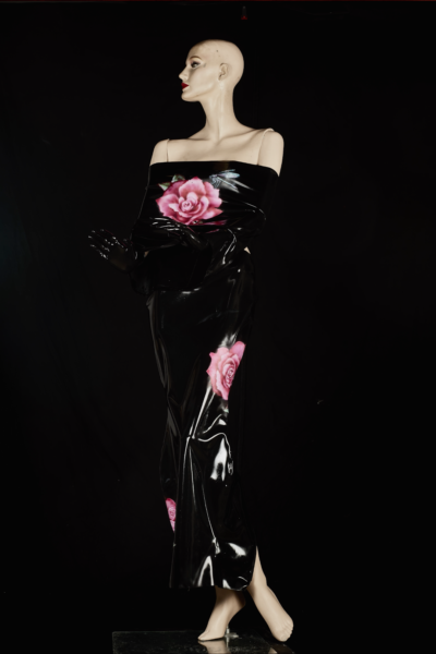 Off shoulder black latex dress on mannequin