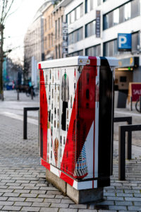 Utility box with photographs of the MoMu collection