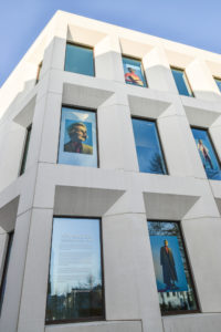 Detail shot of the Antwerp Management School building with pictures of the collection of MoMu Award winner Gennaro Genni Velotti