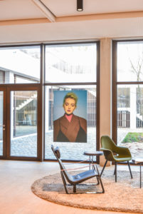 Inside the Antwerp Management School building: Large windows and in the middle a picture of the collection of Gennaro Velotti