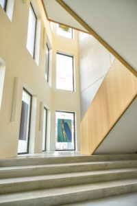 Staircase of the Antwerp Management Schoon building with pictures of the collection of Gennaro Velotti