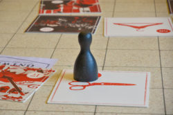 a detail of the game with a pawn and  with an image