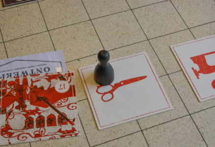 detail of the game, tile and pawn