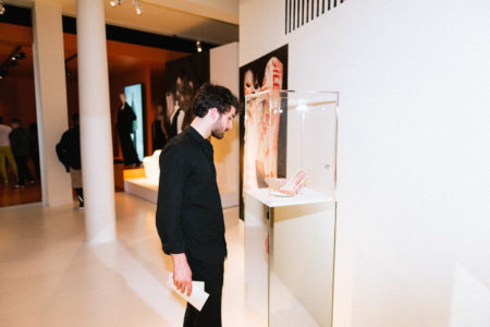 visitor in front of a vitrine